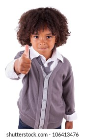 Portrait of a cute african little boy making thumbs up,isolated on white background