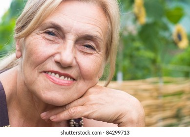 portrait of a cute aged woman at nature