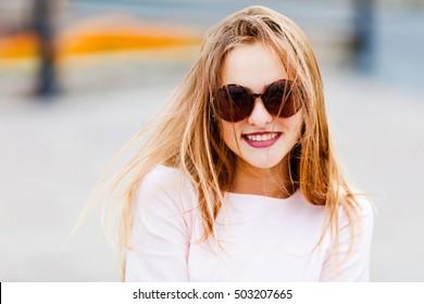 portrait of cute amazing smiling in sunglasses girl,
