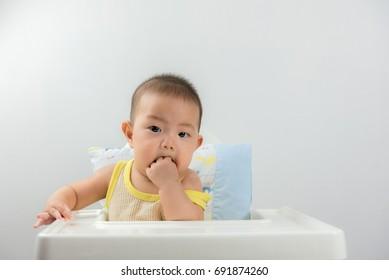Portrait of a cute Asia baby boy Sucking fingers