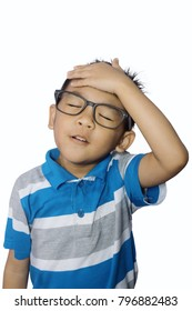 "Portrait of cute asian boy expressing ""oh no!"". Asian boy boy slaps his forehead in an oh-no moment, disappointed, isolated on white background"
