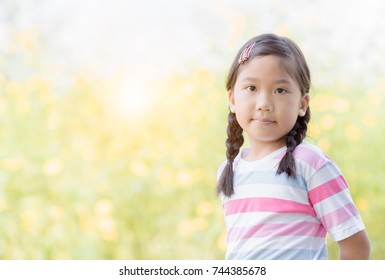 portrait of cute asian little girl smile on nature background