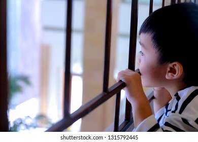 portrait of cute asian lonely young boy