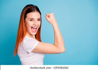 Portrait of cute attractive ecstatic lady youth raise fist open mouth expression shout yell yeah celebration lottery luck lucky fortune isoalted wear fashionable outfit blue background