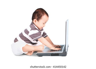 A portrait of cute baby boy typing on laptop computer, isolated on white background