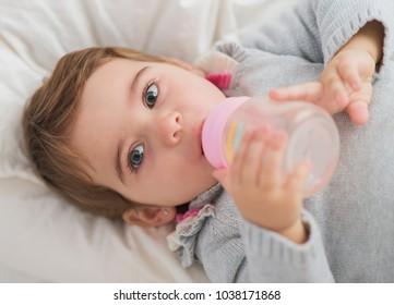 portrait of cute baby drinking water