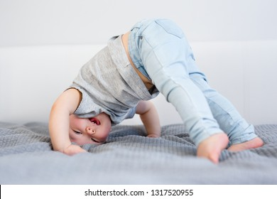 portrait of cute baby girl having fun on the bed