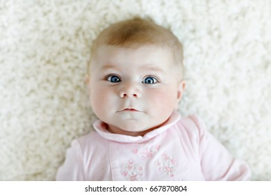 Portrait of cute baby girl looking at the camera. Child of 4 months