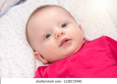 Portrait of cute baby girl lying on back
