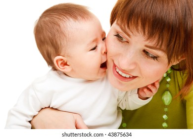 Portrait of a cute baby kissing mother