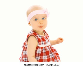 Portrait of cute baby little girl in dress with headband