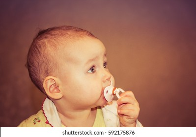 Portrait of a cute baby with a pacifier