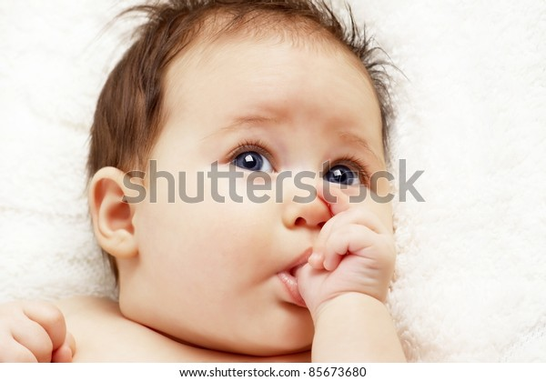 portrait of cute baby sucking finger