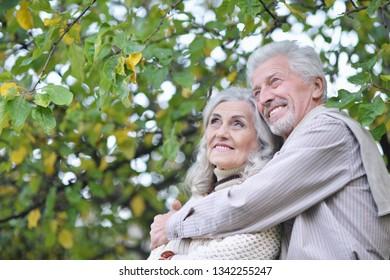 Portrait of cute beautiful senior couple hugging