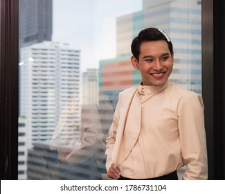 Portrait of cute beautiful young man working in a model office. Transgender people and Equality concept.