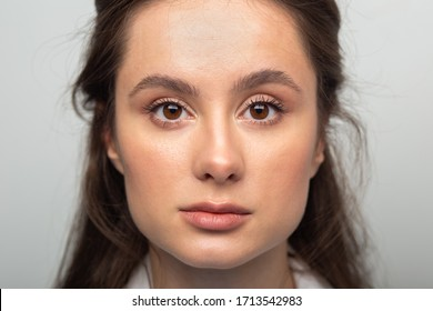 portrait of cute beautiful young woman close-up. woman facing camera with big eyes.