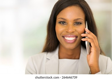 portrait of cute black woman using cell phone