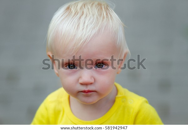 Portrait of cute blond baby