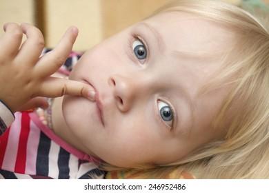 Portrait of cute blond little girl