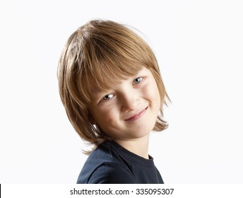 Portrait of a Cute Boy with Blond Hair Smiling