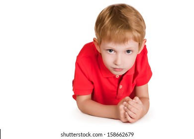 Portrait of a cute boy looking at camera. Isolated over white.