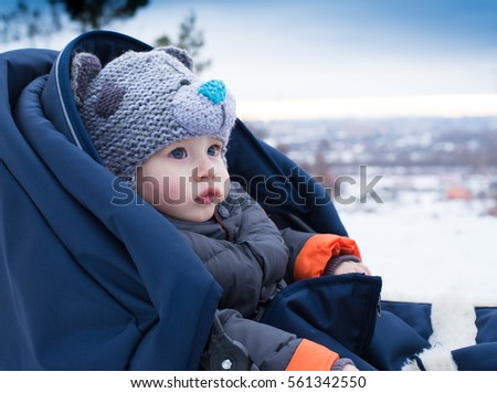 c67fa9e0e54e Portrait of a cute boy on a sled during a family walk in winter. Outdoor  fun for family Christmas vacation. Little boy sitting in a sleigh. - Image