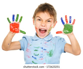 Portrait of a cute boy showing her hands painted in bright colors, isolated over white