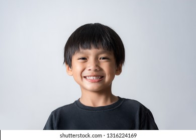 portrait of cute boy smiling, asian boy on white background