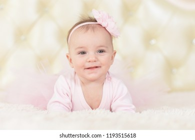 Portrait of cute charming girl in pink dress