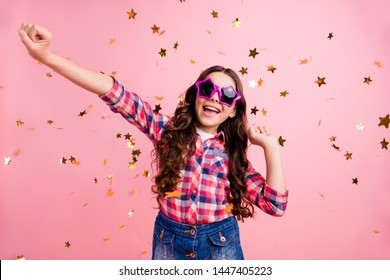 Portrait of cute charming pretty lovely kid child have fun candid content laugh laughter free time celebrate dressed checkered shirt trendy isolated pastel pink background
