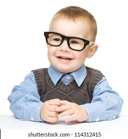 Portrait of a cute cheerful little boy wearing glasses, isolated over white