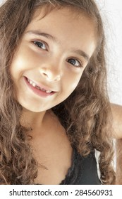 Portrait of a cute child smiling .