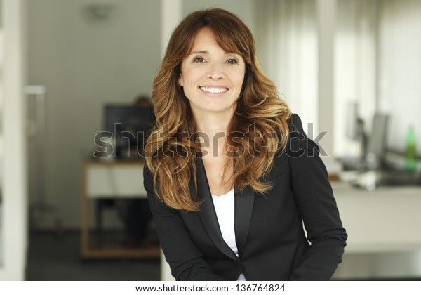 Portrait of a cute confident business woman in office