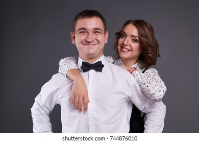 Portrait of cute couple in classic clothes