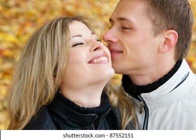 portrait of a cute couple posing outside