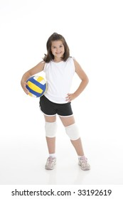 Portrait of a cute eight year old girl in volleyball outfit isolated on a white background