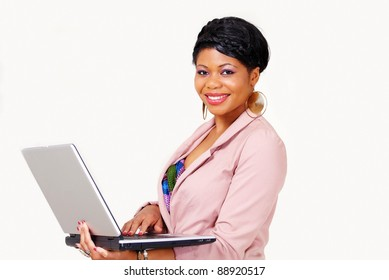 Portrait of a cute ethnic lady standing with laptop and smiling