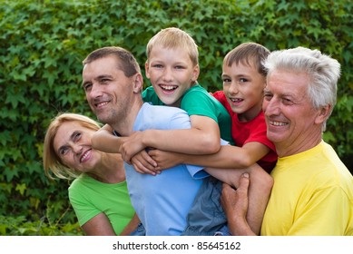 portrait of a cute family at nature