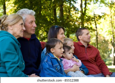 portrait of a cute family at park