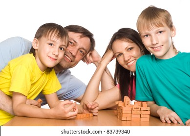 portrait of a cute family playing at table