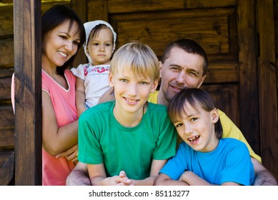 portrait of a cute family posing at house