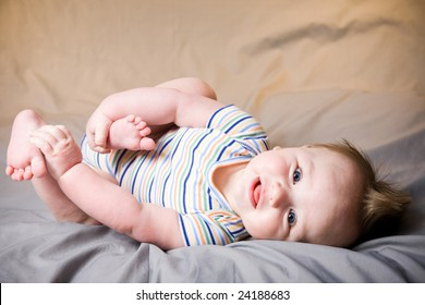 A portrait of a cute five month old baby boy. Shallow depth of field.