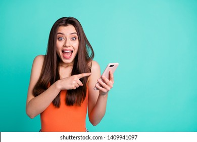 Portrait cute funky astonished lady impressed unbelievable unexpected incredible notification advice choose decide feedback singlet tank-top orange long hairdo stylish trendy isolated teal background