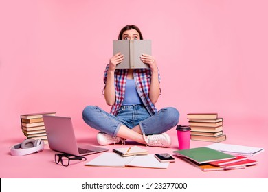 Portrait of cute funny funky lady person hold hand take printed book literature fiction hide astonished impressed reaction wear checked short denim jeans isolated pink background