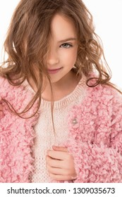 Portrait of a cute girl. The Child is looking directly at the camera and smiling.