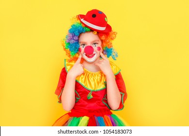 Portrait of cute girl clown , toothy smiling, looking at camera
