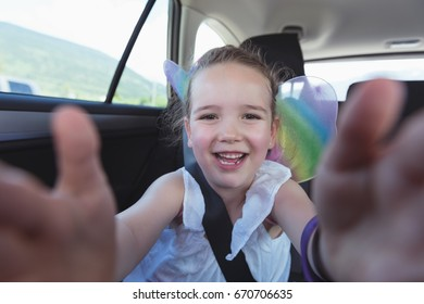 Portrait of cute girl enjoying in car