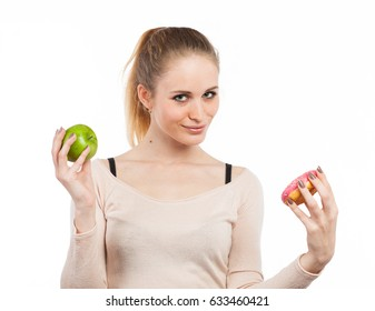 Portrait of a cute girl with a green apple and a donut, isolated on white