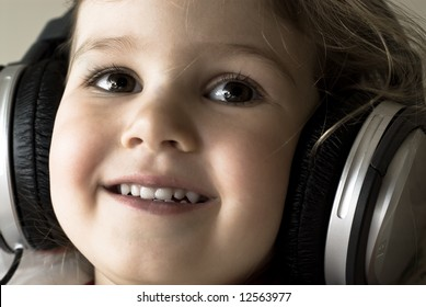 Portrait of cute girl with headphones listening to music