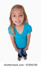 Portrait of a cute girl looking at the camera against a white background